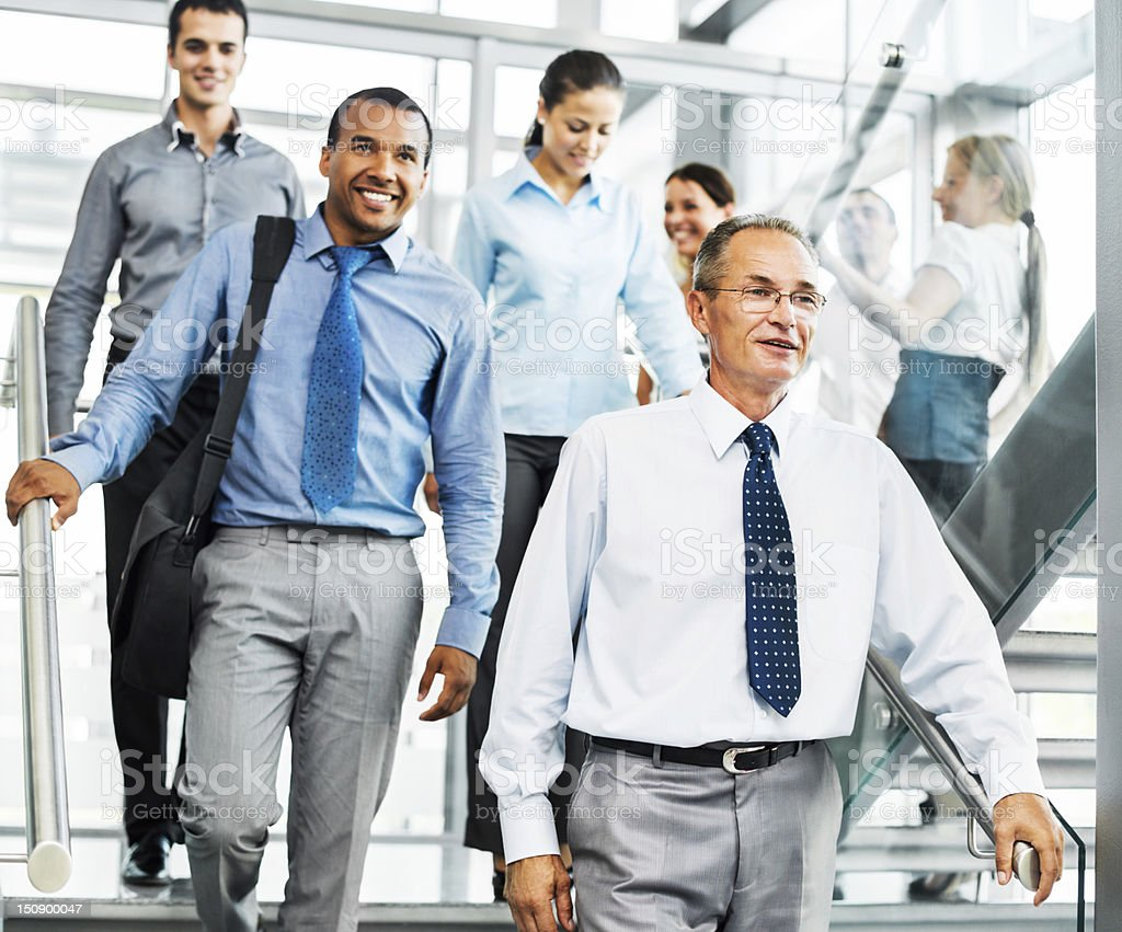 Group of smiling businesspeople on the staircase royalty-free stock photo