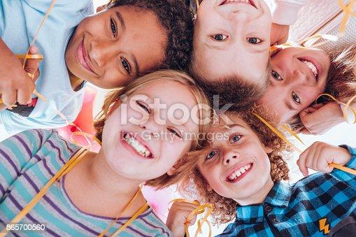 istock Group of smiling children 865700560