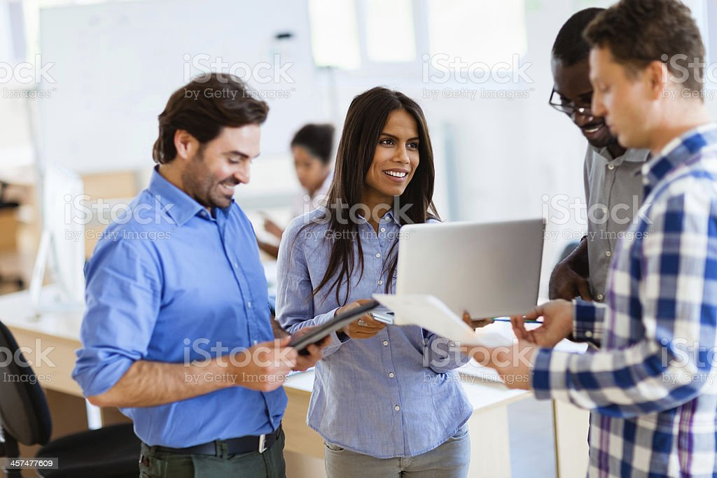 Group of smiling designers working on a project royalty-free stock photo