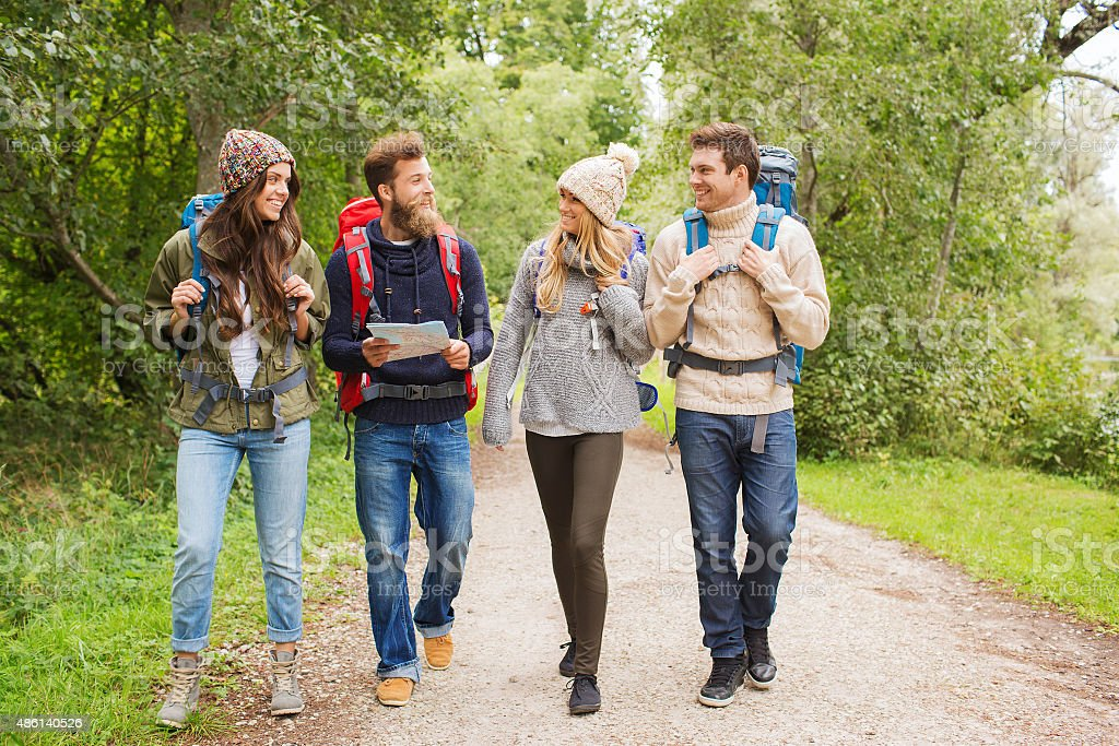 group of smiling friends with backpacks hiking - Royalty-free 2015 Stock Photo