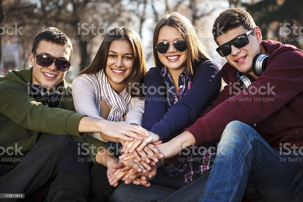 Group of smiling friends with joined hands royalty-free stock photo