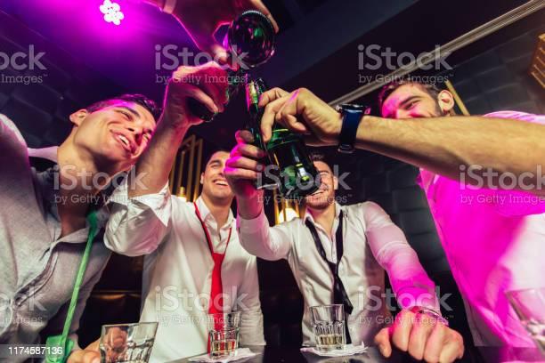 Group of smiling male friends having fun in night club picture id1174587136?b=1&k=6&m=1174587136&s=612x612&h=w2ixkpra wwmmda ots49xufnn6ju2n8torohjee4r8=