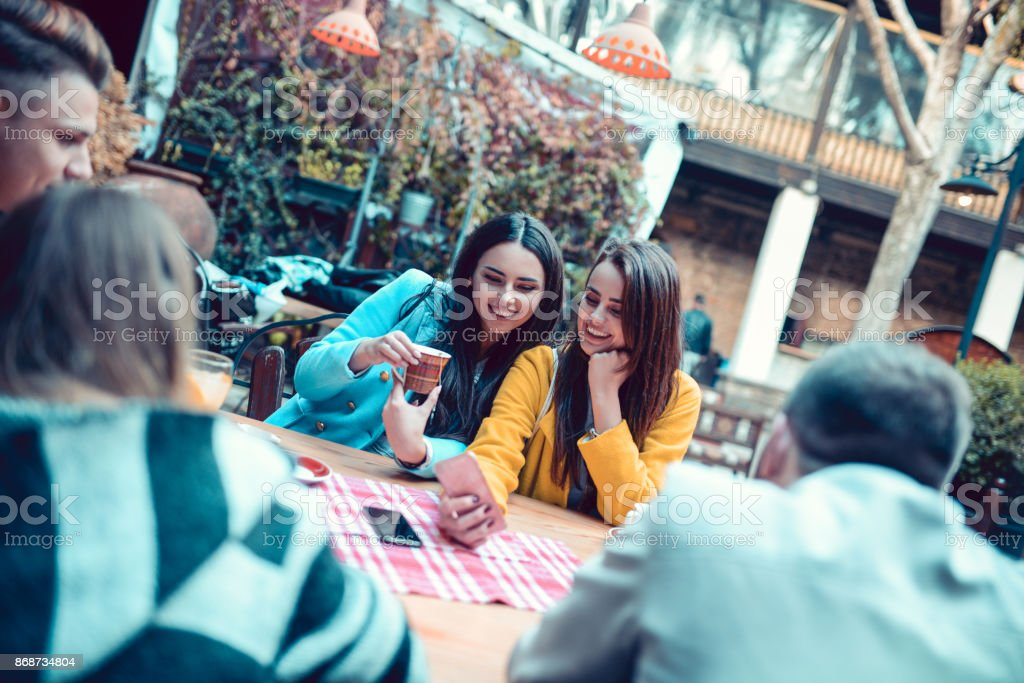 Group Of Smiling People Drinking Coffee And Socialising At Traditional Cafe Restaurant Stock Photo Download Image Now Istock