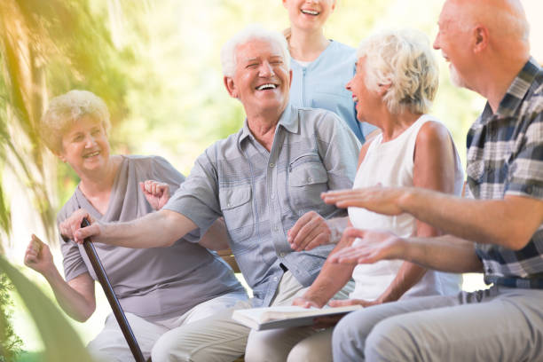 group of smiling senior friends - elderly group stock photos and pictures
