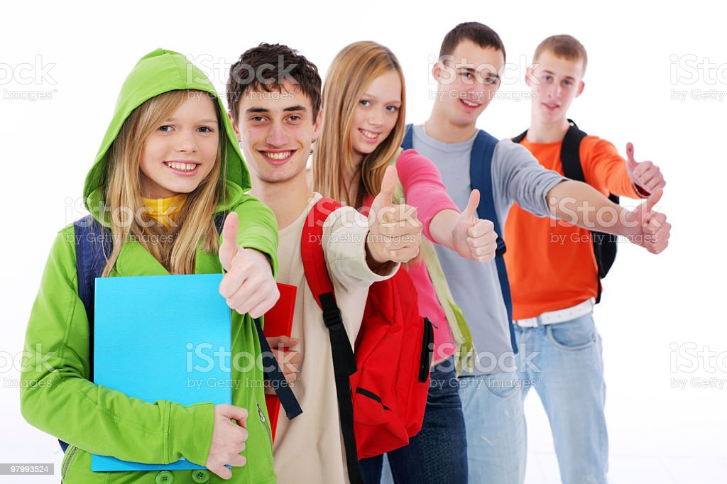 Group of smiling teens showing ok. royalty free stockfoto