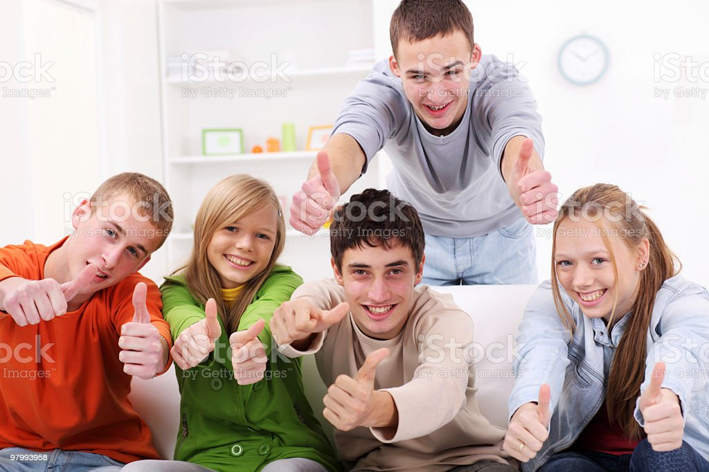 Group of smiling teens showing ok. royalty-free stock photo
