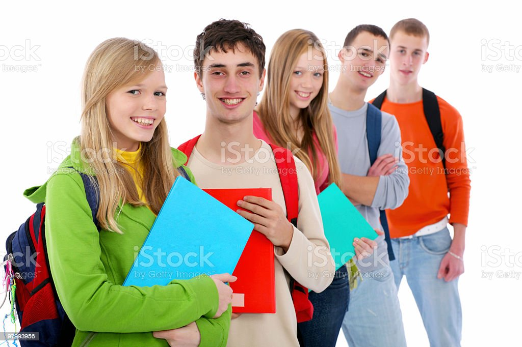 Group of smiling teens standing in a row. royalty-free stock photo
