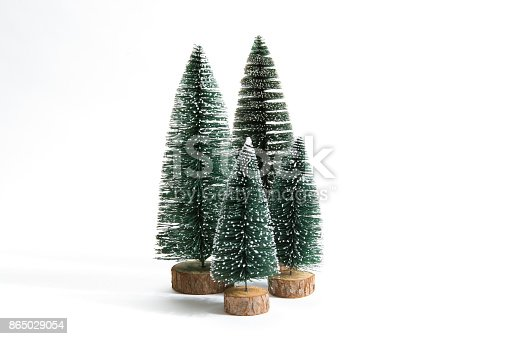 Isolated group of full artificial firs like a small forest tree on a white background. Minimal still life photography