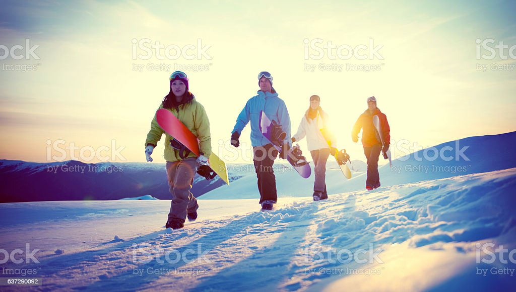 Group of Snowboarders on Top of the Mountain Concept stock photo