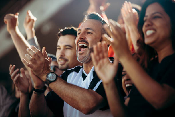 Group of soccer fans cheering their national team stock photo
