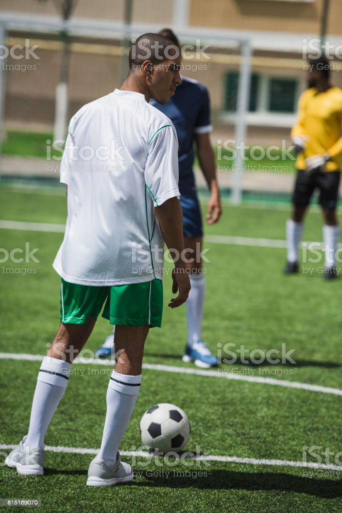group of soccer players during soccer match on pitch