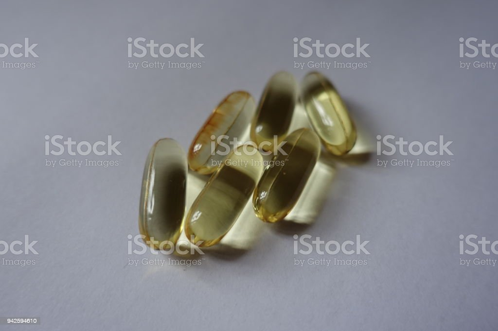 Group of softgel capsules of fish oil stock photo