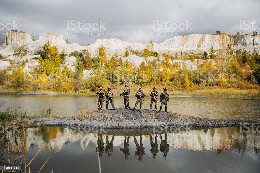 group of solders standing and looking at the camera stock photo