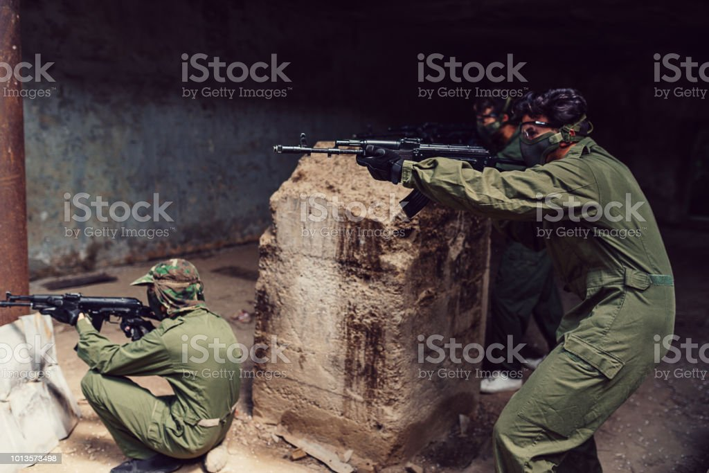 Group of soldiers aiming with guns stock photo