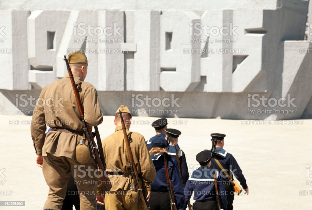 Group of soldiers and sailors wearing old retro USSR military uniform stock photo