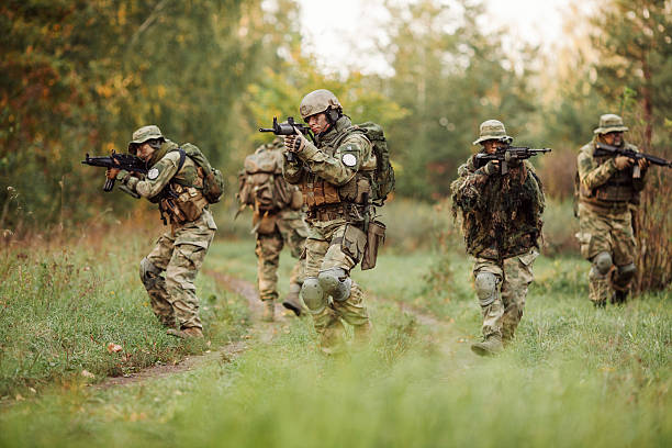 group of soldiers engaged in the exploration area group of rangers was ambushed and returned fire leads battlefield stock pictures, royalty-free photos & images