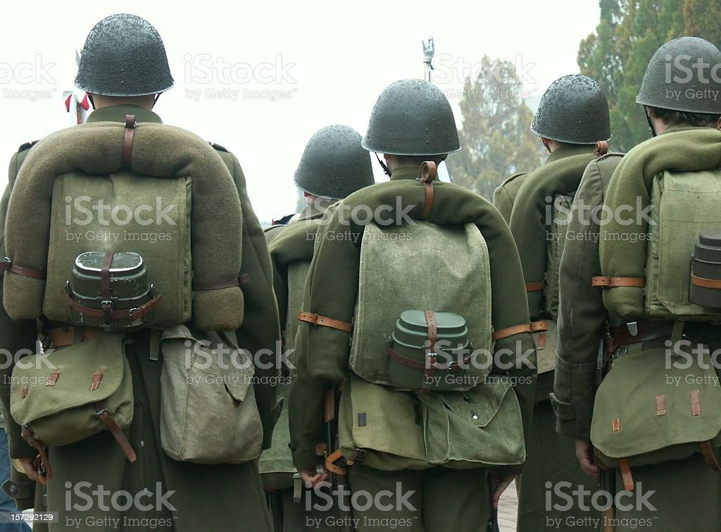 Group of soldiers from the back in a cluster stock photo