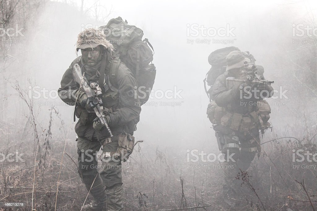 Group of soldiers in the smoke stock photo