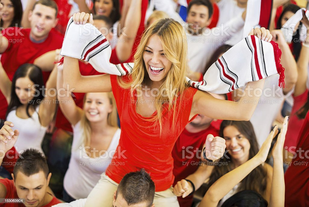 Group of sport fans cheering. stock photo