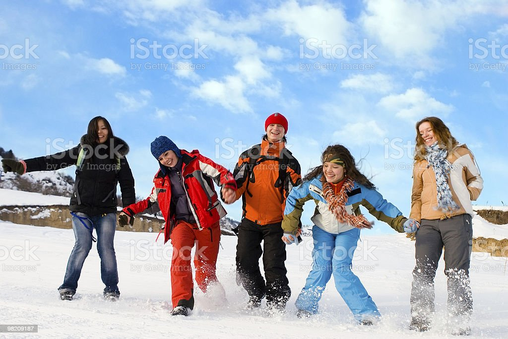 Group of sport teens different ethnicity jumping at mountain royalty-free stock photo