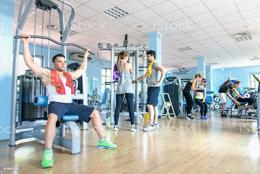 Group of sportive friends at gym fitness club center studio stock photo