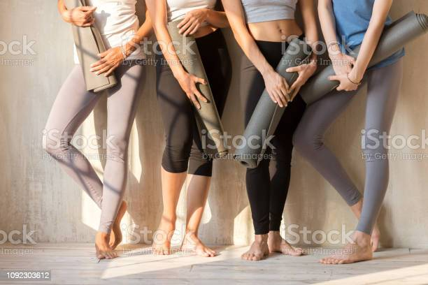 Group of sportive girls in a row with yoga mats picture id1092303612?b=1&k=6&m=1092303612&s=612x612&h=jgvg8quiywaivz 9kdjx6j szzu6ebuzx0vs7n qirw=