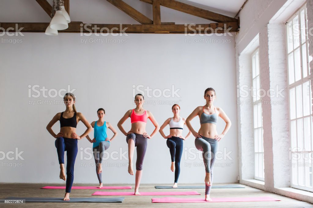 Group of sportive people in a gym training. royalty-free stock photo
