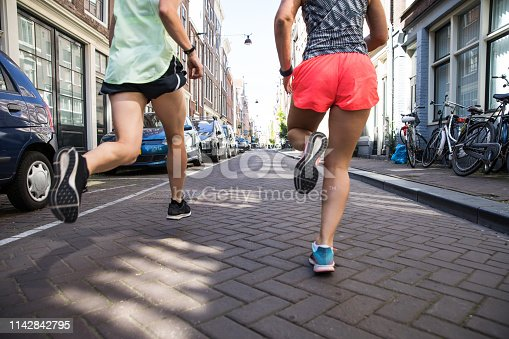 Group of sportive team of runners training in the city of Amsterdam, Netherlands - Europe