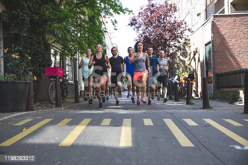Group of sportive team of runners in the city of Amsterdam