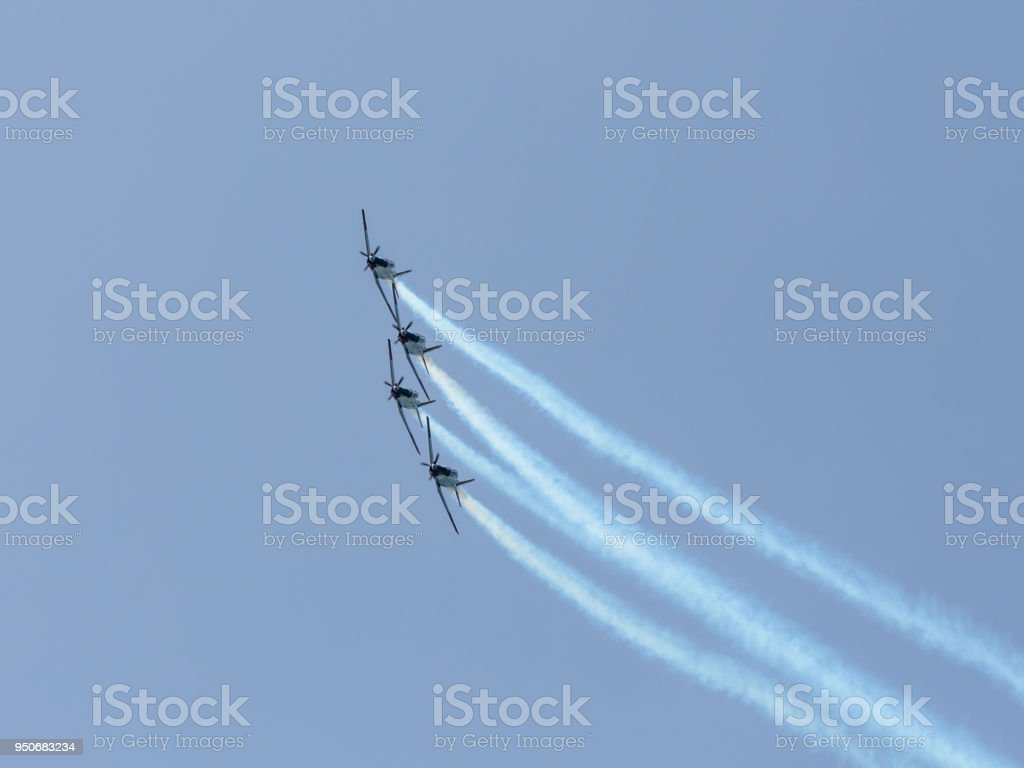 A group of  sports airplanes show in the sky an aerobatic show dedicated to the 70th anniversary of the Independence of Israel stock photo