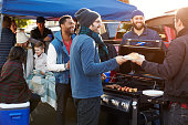 istock Group Of Sports Fans Tailgating In Stadium Car Park 502869344