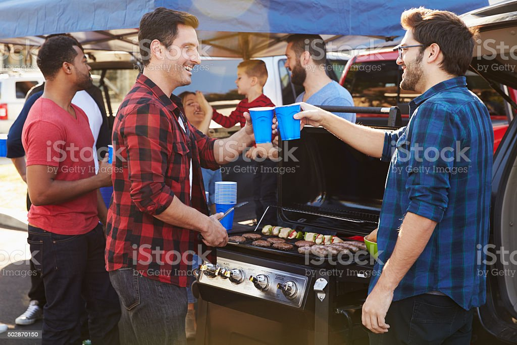 Group Of Sports Fans Tailgating In Stadium Car Park stock photo