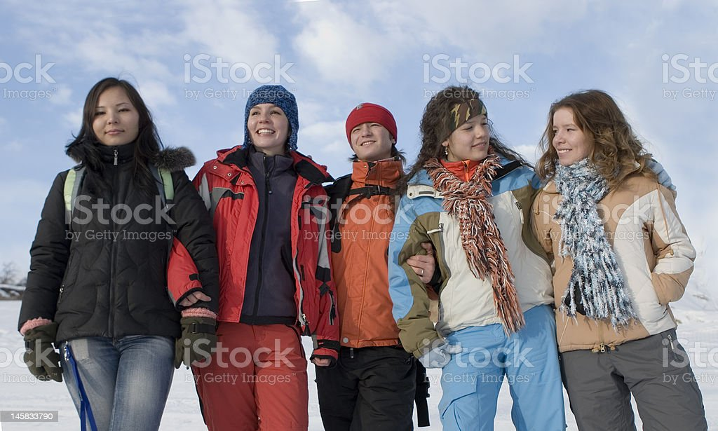 Group of sports teenagers in mountains royalty-free stock photo