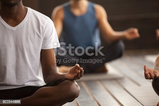 istock Group of sporty people in Easy Seat pose, close up 922344888