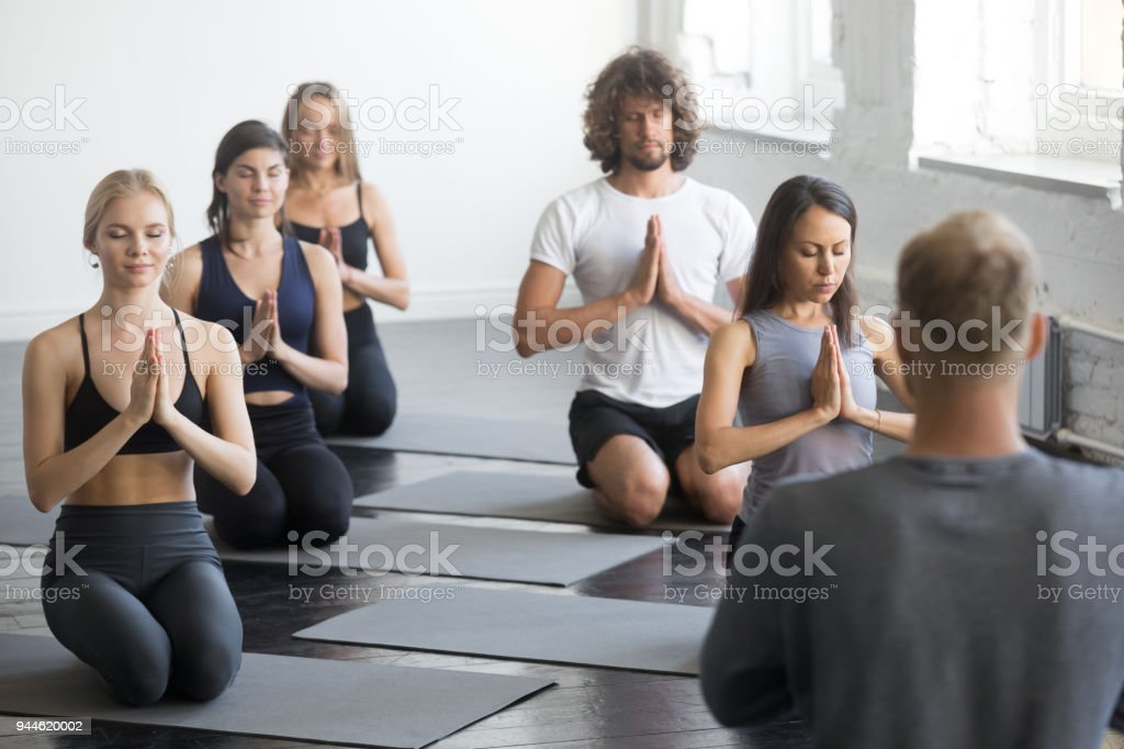 Group of sporty people in vajrasana exercise stock photo