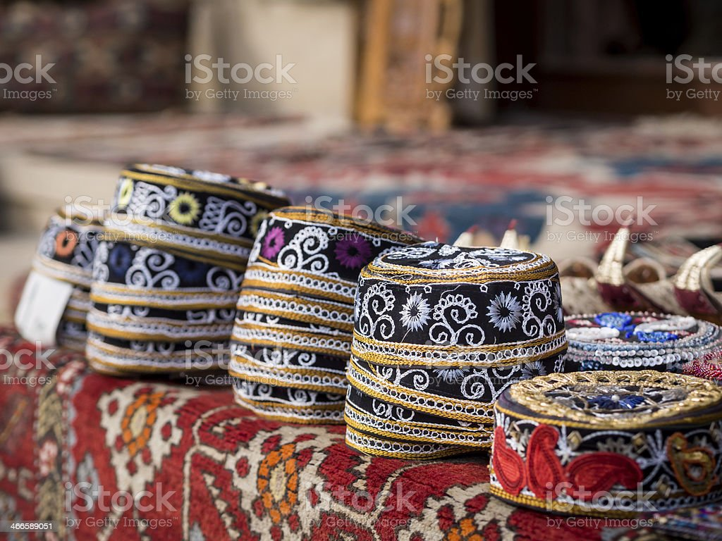 Group of stacked Azerbaijani hats laid out on table stock photo