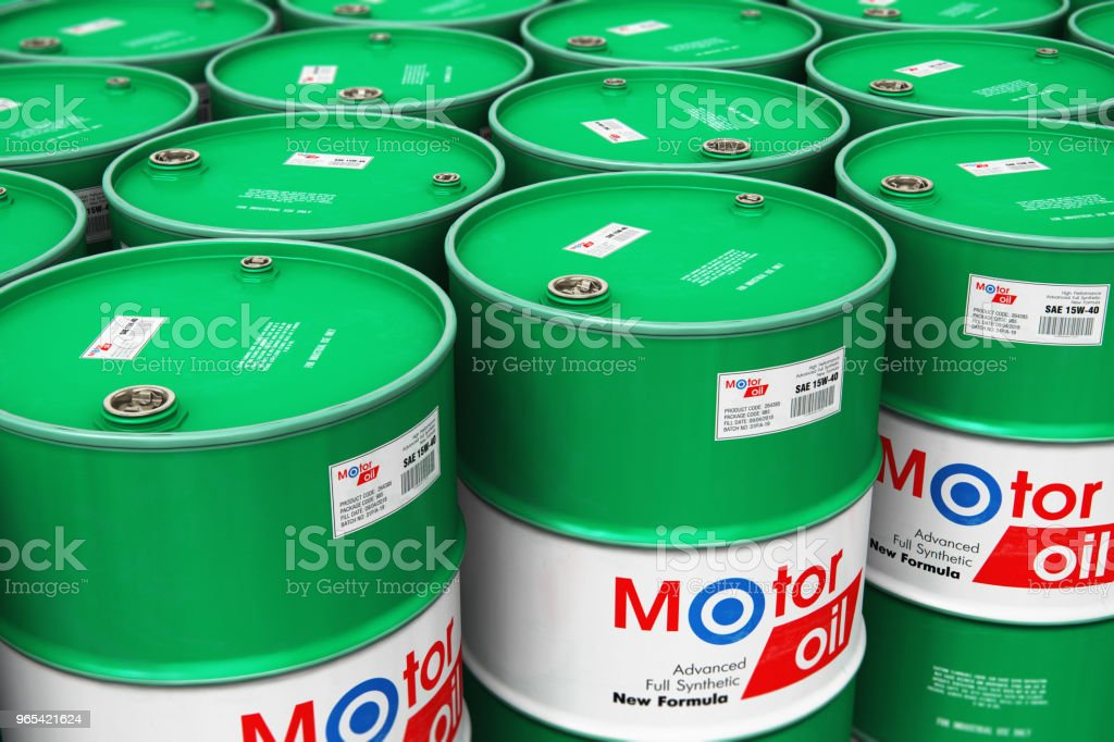 Group of stacked barrels with motor oil lubricant in warehouse royalty-free stock photo