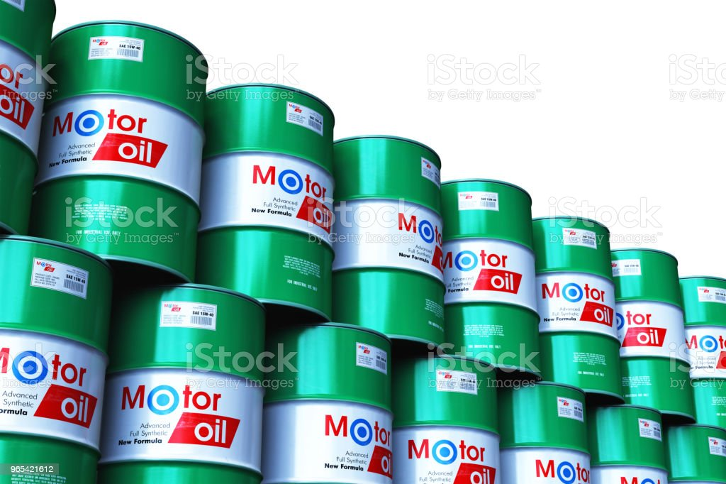 Group of stacked barrels with motor oil lubricant isolated on white royalty-free stock photo