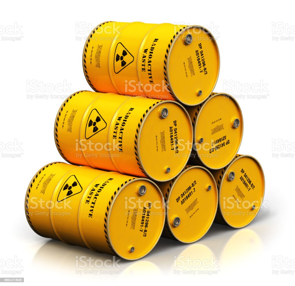 Group of stacked yellow drums with radioactive waste isolated on white zbiór zdjęć royalty-free