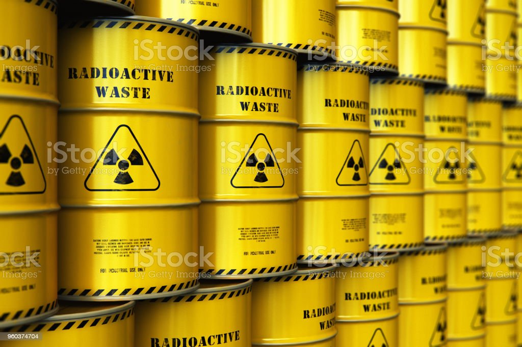 Group of stacked yellow drums with radioactive waste stock photo