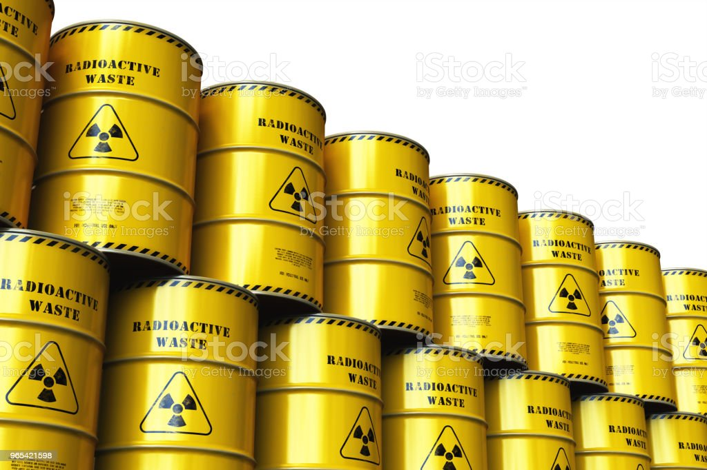 Group of stacked yellow drums with radioactive waste royalty-free stock photo