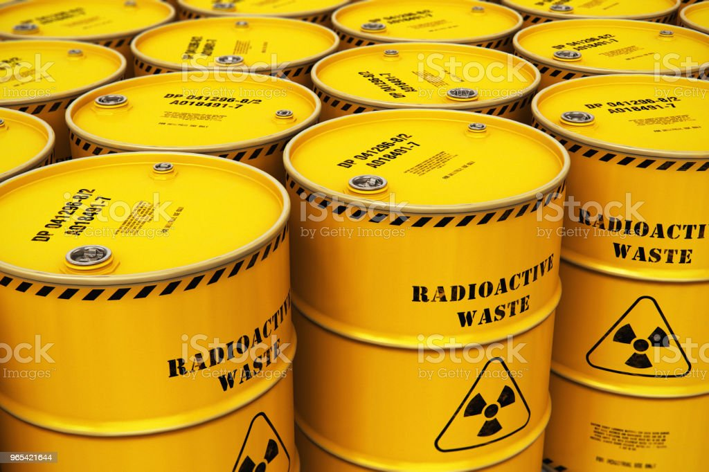 Group of stacked yellow drums with radioactive waste zbiór zdjęć royalty-free