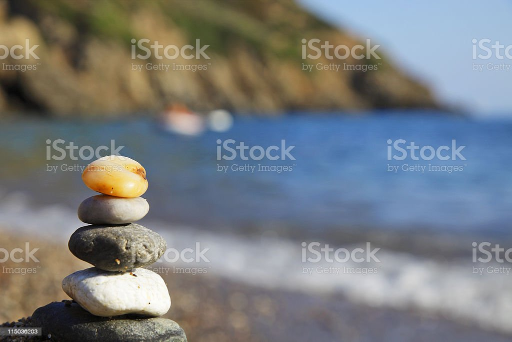 group of stones against water coastline royalty-free stock photo