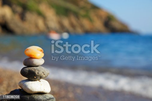 591835714 istock photo group of stones against water coastline 115036203