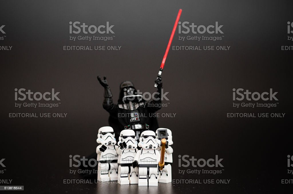 Group of Stormtroopers take a selfie with Darth Vader stock photo