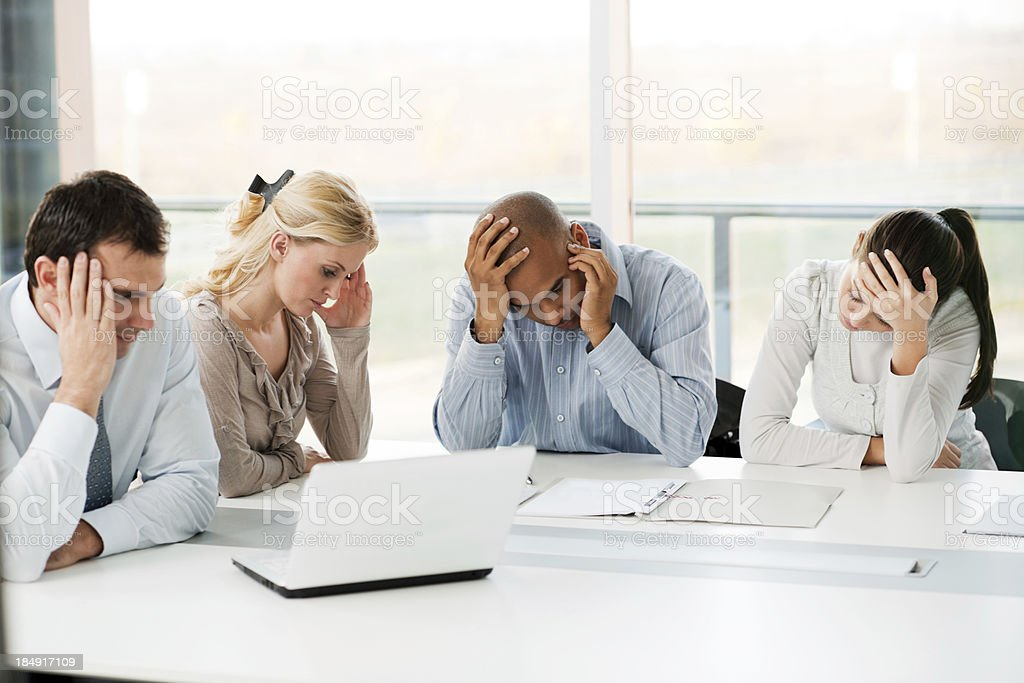 Group of stressful businesspeople having problems. stock photo