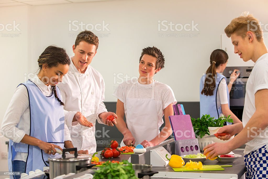 Group of Student Chefs Learning with Instructor stock photo