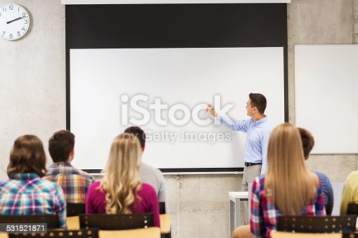 640177838 istock photo group of students and smiling teacher in classroom 531521871