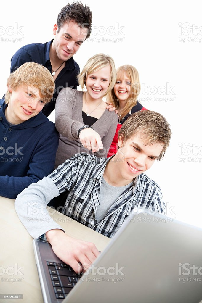 Group of students around laptop royalty-free stock photo