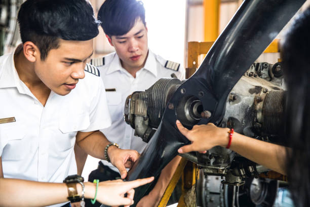 Group of Students at Aviation University during practical class Group of Students at Aviation University during practical class in Bangkok - Thailand. flight suit stock pictures, royalty-free photos & images